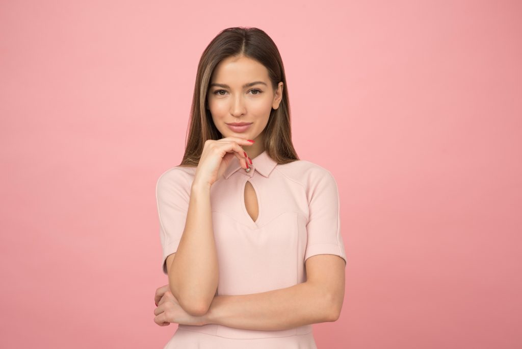 woman wearing pink collared half sleeved top 1036623